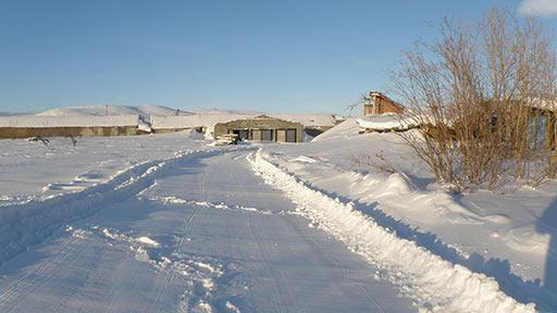 Первый проход волокушей по снежным колеям